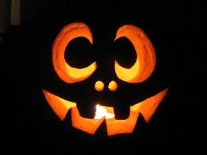 smiling jack o lantern with lit candle